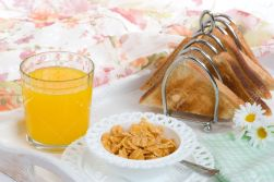4936060-Morning-breakfast-with-cereal-toast-and-a-glass-of-orange-juice-Stock-Photo